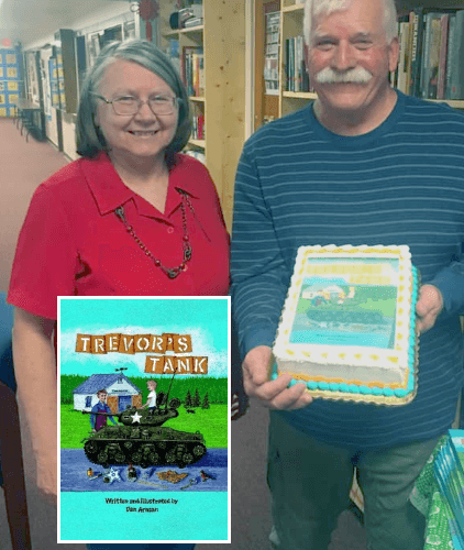 Dan Arnsan and Library Director Guna and a Trevor's Tank Story Cake!